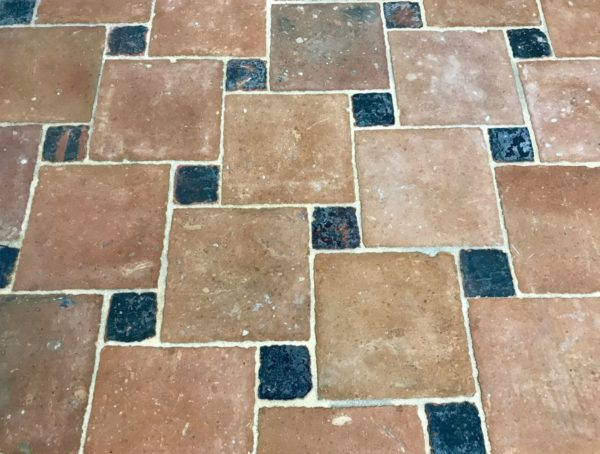 antique terra-cotta tiles in square with tiles
