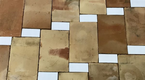 reclaimed parefeuille and glazed rectangle floor tiles