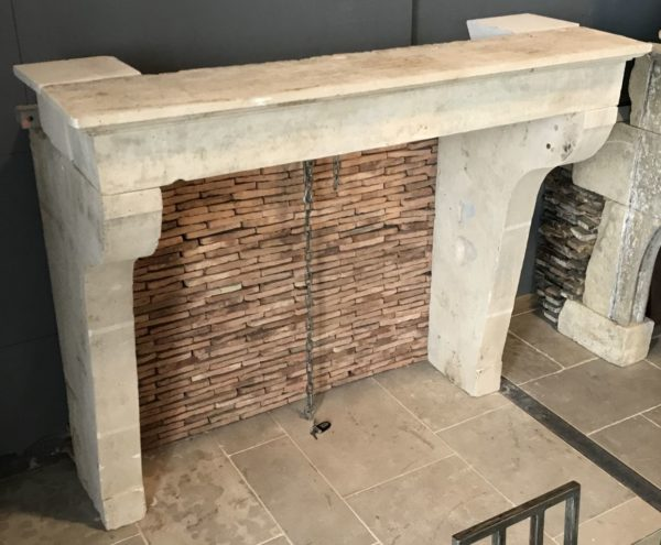limestone farmhouse fireplace with terra cotta brick inside