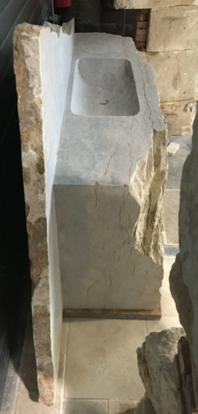 limestone washbasin in rock