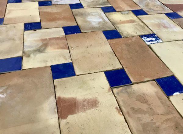 reclaimed terractotta floor with blue zellige