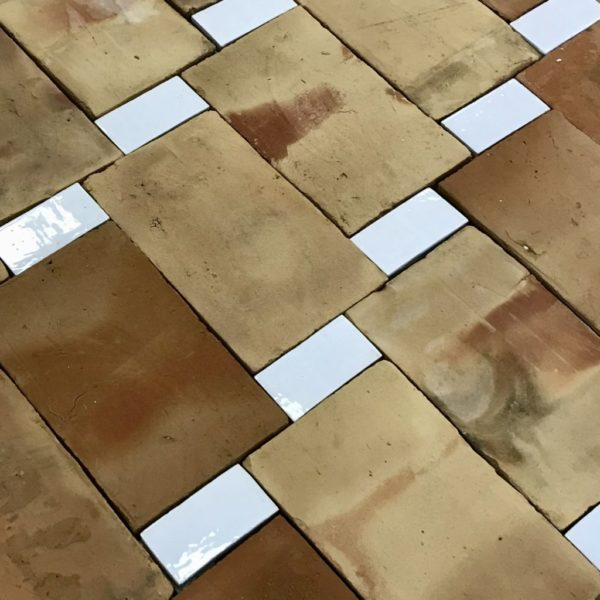 reclaimed terracotta floor with white rectangulat glazed tiles