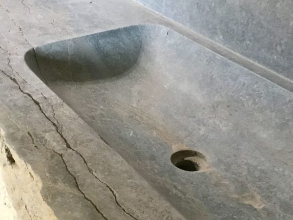 washbasin carved in a piece of rock