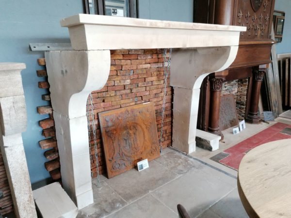 antique farmhouse fireplace mantel in showroom