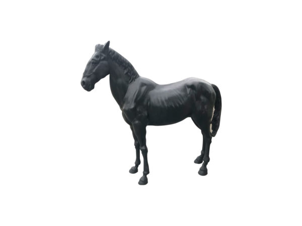 life size statue of a black horse in iron