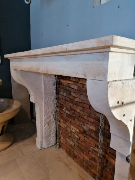antique fireplace mantel in limestone