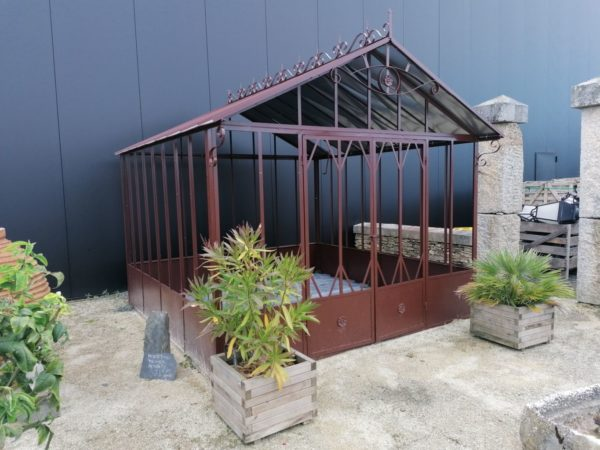 brown greenhouse with glass
