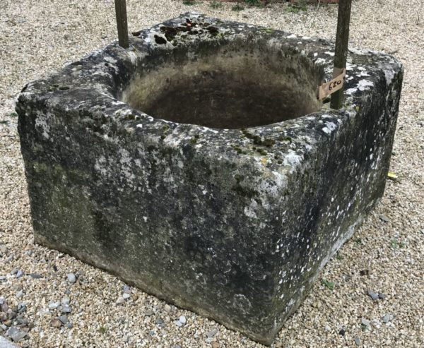 antique stone well with leg gantry