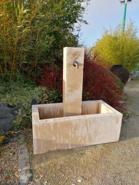 large new limestone fountain in beige color