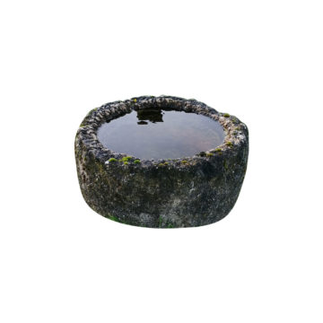 old circular stone trough