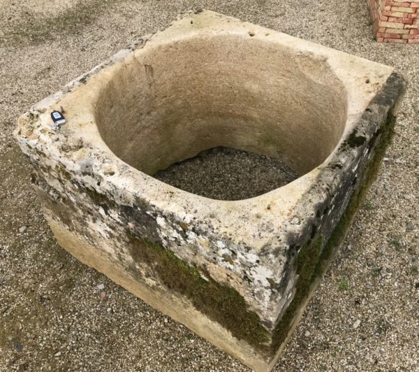 antique french limestone wellhead in limestone from France