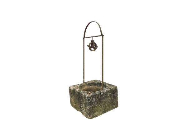 antique limestone well with two leg in iron gantry