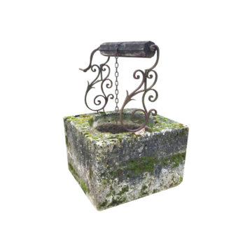 antique limestone wellhead with wrought ironwork