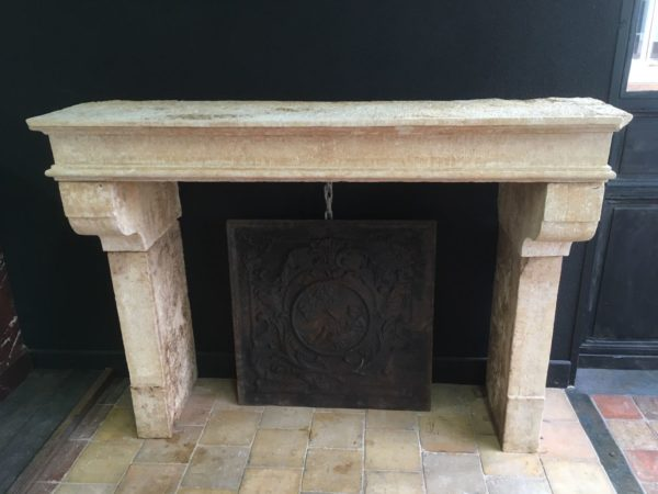 A beige and cream antique fireplace