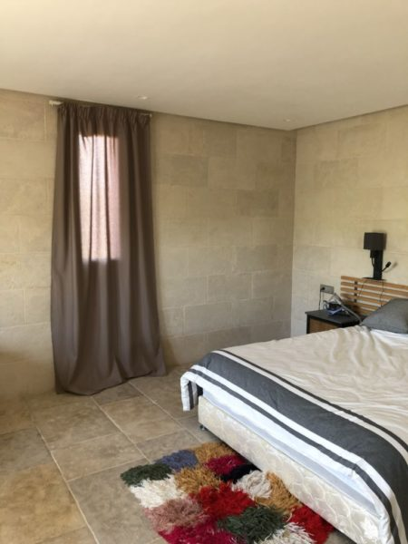 beige limestone wall cladding in a room