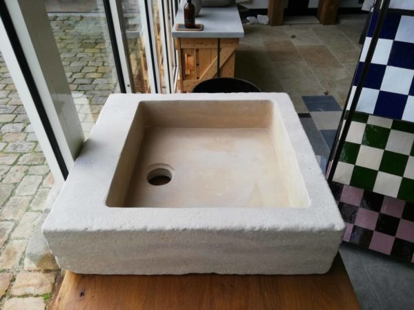 beige mera stone sink with soft finish at the left