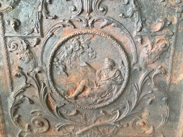cast iron fireback with a angel in black color