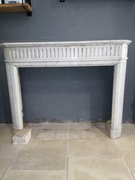 picture in front of the white marble mantel