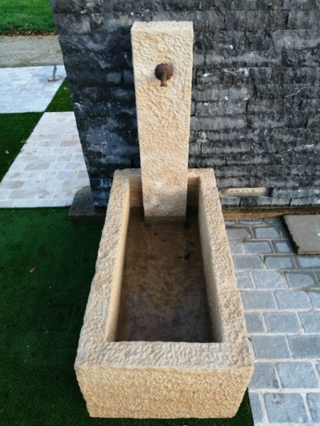 picture at the superior of the small fountain with hand tooled patina