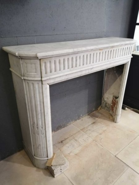 white mantel antique marble in left side