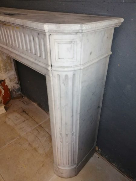 details of the fireplace lintel in white marble