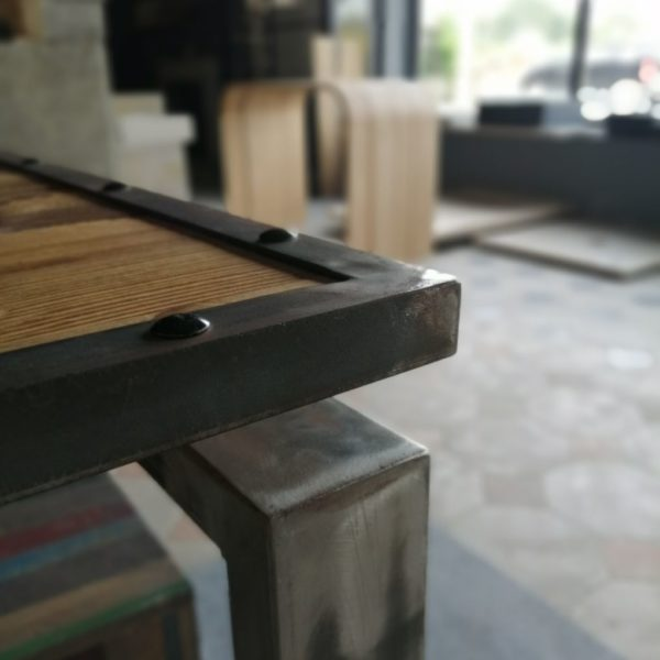 large metal table in pine