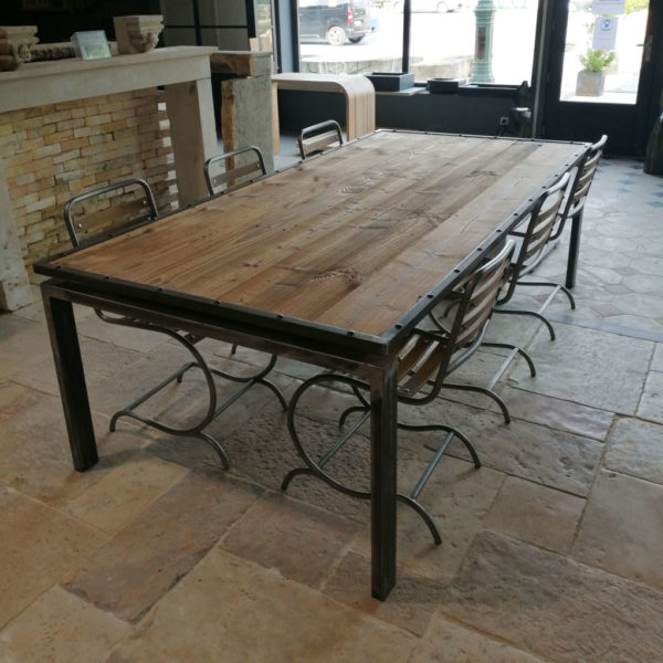 large metal table with pine at the top