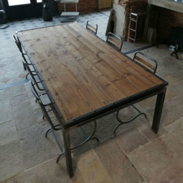 large metal table with chair and pine