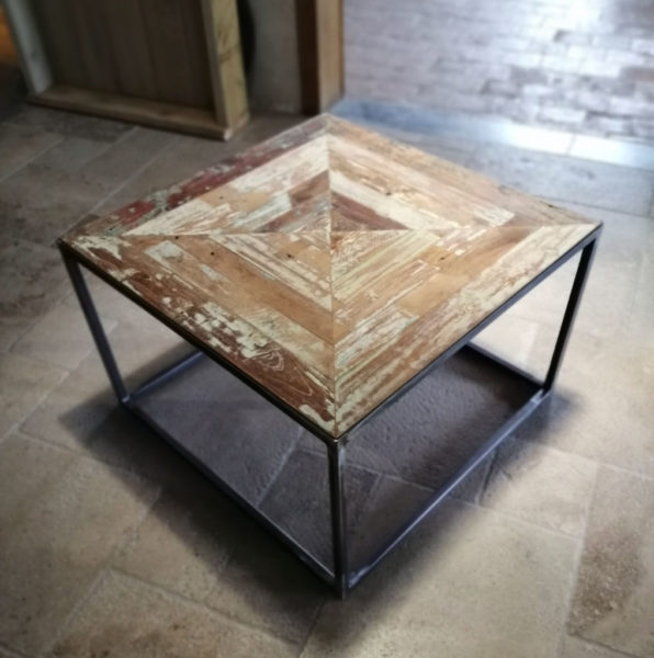 metal table with a old teak top