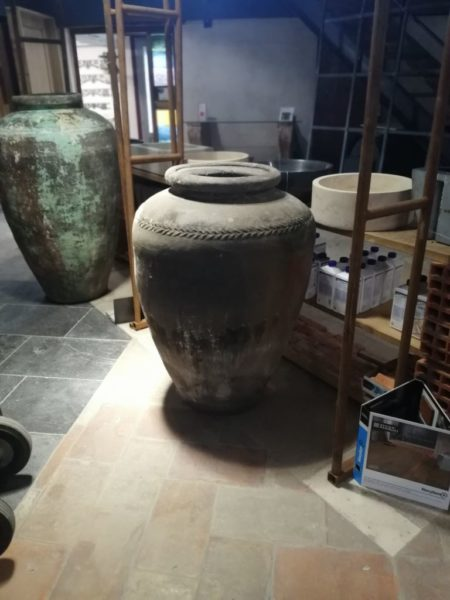 terra-cotta jar with and old patina in white color