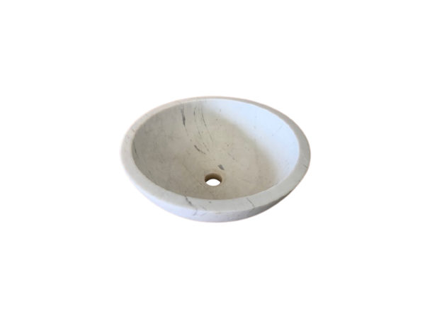 rounded white marble washbasin