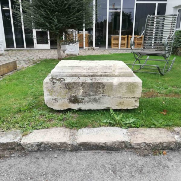 limestone plinth in a garden