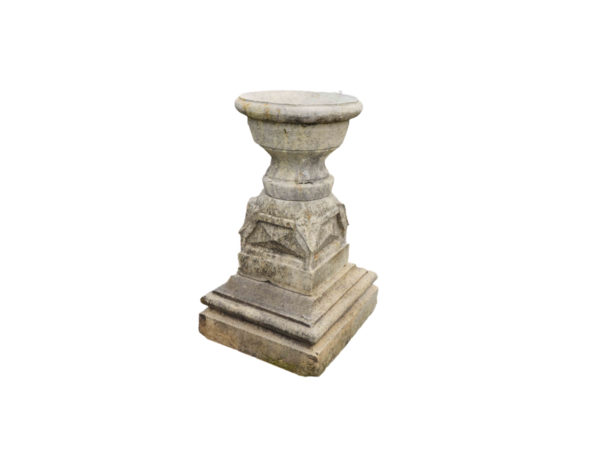 antique limestone pedestal with vase