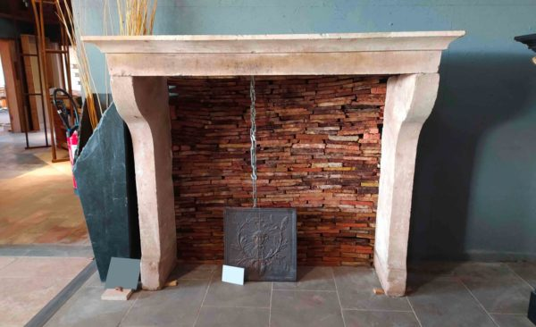 farmhouse limestone fireplace