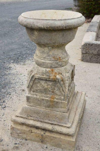 old pedestal in limestone