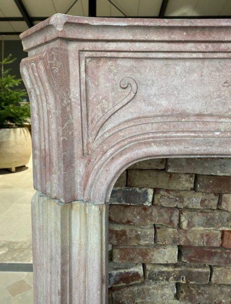 Pink chimneypiece in limestone